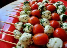 2sistersrecipes.com: Easy Mozzarella & Tomato Kabobs  I just bought the marinated mozzarella balls from Costco. Can't wait to try.