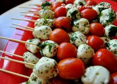 2sistersrecipes.com: Easy Mozzarella & Tomato Kabobs  I just bought the marinated mozzarella balls from Costco. Can't wait to try.
