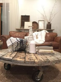 Love this farmhouse style coffee table made from a cable spool.