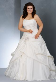 This exquisite taffeta plus size wedding dress has a draping gathered skirt with a beaded applique at the waist.
