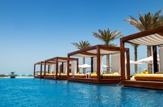 Luxury beds by the pool in Dubai
