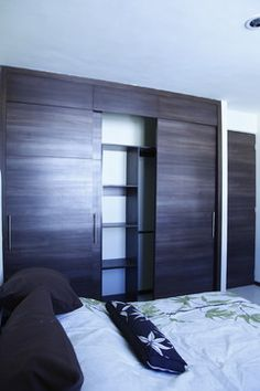 Condo master bedroom on pinterest sliding closet doors for Modern built in closet