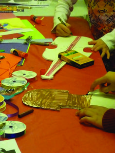 """Making their own """"Painted Violin"""" in honor of the HSO's Painted Violin fundraiser (violin's cut out of foam core for the kids to color and decorate with ribbons, markers, stickers etc)"""