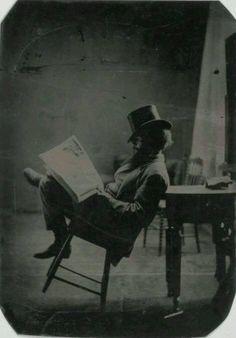 Portrait of a gentleman reading the newspaper, c.1880