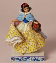 Disney Traditions by Jim Shore Snow White Winter Figurine, 7-1/4-Inch - A lovely tribute to winter and one of Disney's famous beauties.  $34.00