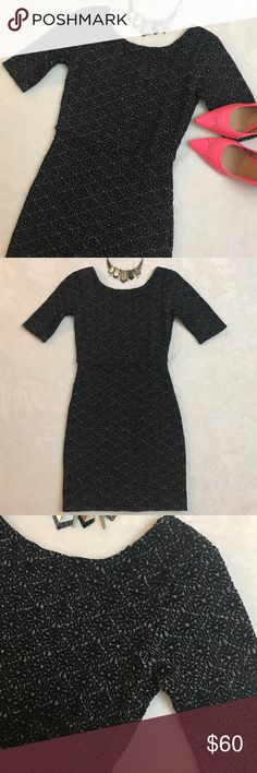 FREE PEOPLE Black Gray Scoop Back Bodycon Dress FREE PEOPLE Black Gray Scoop Back Bodycon Dress size XS. Features a deep scoop back, 1/2 sleeves and a figure hugging stretch. Bust measures 27 inches, waist is 24 inches, length is 31.5 inches. All measurements are unstretched. Lined. Polyester/rayon/spandex. Free People Dresses