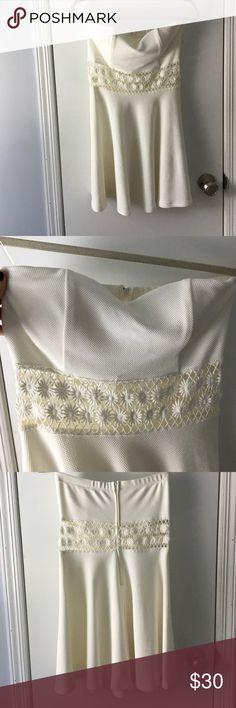 Lulus white sundress Strapless white dress with crochet waist detailing. Never worn! Super cute for a graduation or summer BBQ! Lulu's Dresses Mini