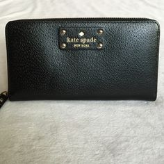 """$145 Black Kate Spade Neda Wellesley Wallet Black Kate Spade Neda Wellesley Wallet. Boarskin embossed leather with matching trim.  14-karat light gold plated hardware. Zip around continental wallet. Interior features 12 credit card slots, 3 billfolds, and zipper change pocket. Exterior features one open slide pocket. Dimensions 7.6""""x3.9"""" kate spade Bags Clutches & Wristlets"""