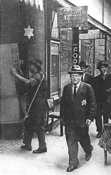 Jews moving into one of the 2,000 buildings in Budapest marked with a yellow star. In March 1944, German forces occupied Hungary. Jews were hurriedly concentrated in ghettos or, as in Budapest, in houses as a first step to their deportation. The Hungarian pro-Nazi regime had earlier introduced restrictions on its own Jewish population, they mainly deported or killed Jews in the territories occupied from Yugoslavia, Slovakia and Ukraine.