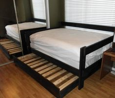 This is an example of our Basic Full Day Bed with Full Trundle . (shown with optional black stain) This particular Full Day Bed has custom-height arms and back.   The arms are lower than the back,...