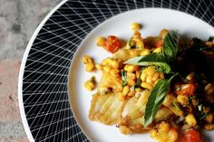 sautéed fresh dover sole, tomatoes, garlic, chili flakes, corn nuts, basil