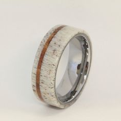 Deer Antler Ring with Oak Pinstripe and Titanium Sleeve. Neat idea but I would chose different materials