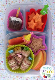 "Mini cupcake, organic carrots and apples, home-made ""cookie spread""  uncured ham, cheese, and mustard sandwich bite ""presents!"""