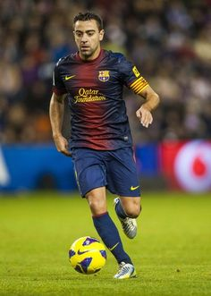 """""""Xavi is a player who has the Barcelona DNA: someone who has the taste for good football, someone who is humble and someone who has loyalty to this club. """" Pep Guardiola"""