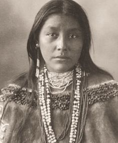 """Shoshone woman - The name """"Shoshone"""" comes from Sosoni, a Shoshone word for high-growing grasses. Some neighboring tribes call the Shoshone """"Grass House People,"""" based on their traditional homes made from soshoni'. Shoshones called themselves Newe, meaning """"People.""""  Meriwether Lewis recorded the tribe as the """"Sosonees or snake Indians"""" in 1805"""