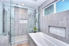 Contemporary Full Bathroom with Rain shower, High ceiling, limestone tile floors, frameless showerdoor, Handheld showerhead