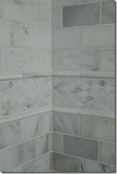 carrera marble border think this idea but in the yellow tones imagine a white subway tile field with black accent tile inset with the marble border