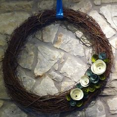 Grapevine wreath with precious paper roses. So cute!