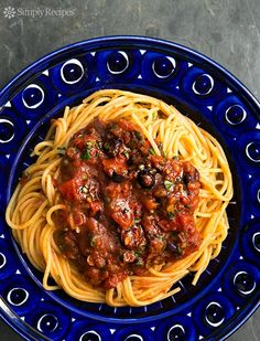 "Best ""lazy day"" pasta! Sauce made from pantry ingredients—onion, garlic, canned tomatoes, capers, and olives. So good! On SimplyRecipes.com"