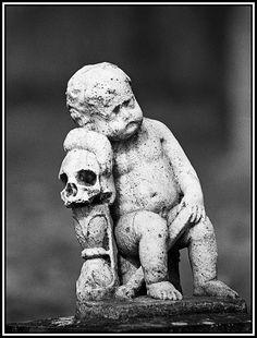 stone child and skulls