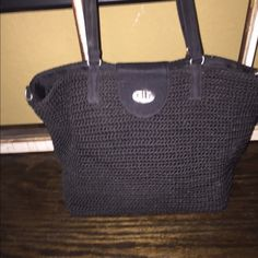 Women's crocheted style handbag Black crocheted bag with leather straps and silver tab closure. No rip or tears in lining. In excellent condition Bags Shoulder Bags
