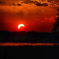The eclipse over Lake Grapevine in Texas. More: Rare eclipse crosses Asia, western U.S.