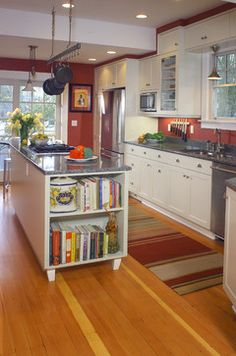 Island with built in bookcase and furniture feet traditional kitchen