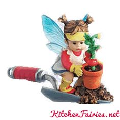 Freshen up your vegetable garden with the Potting Kitchen Fairie. Standing on a gardening hoe, she squats down to lift a potted tomato plant from a mound of dir