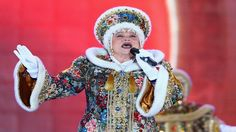 SOCHI, RUSSIA - FEBRUARY 09: A traditional Russian singer performs during the medal ceremony on day 2 of the Sochi 2014 Winter Olympics at Medals Plaza.