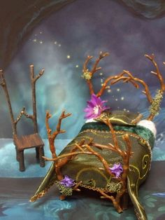 Fairy bed - LOVE the little details in the twisting twigs! (inspiration only) ******************************************* Kiva's Miniatures - #fairy #garden #gardening #miniature #miniatures #furniture #crafts #twig #DIY - tå√
