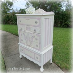 Old dresser repainted with white, added borders, stripes