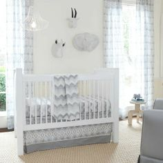 Love these colors for a gender neutral nursery!    Stella Ikat Crib Bedding | Gray and White Ikat Pattern Gender Neutral Crib Set | Carousel Designs #nursery #baby