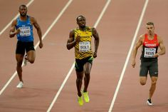 (L-R) Rolando Palacios of Honduras, Usain Bolt of Jamaica and Julian Reus of Germany compete in the Men's 200 metres heats during day four of the 15th IAAF World Athletics Championships Beijing 2015 at Beijing National Stadium on August 25, 2015 in Beijing, China.