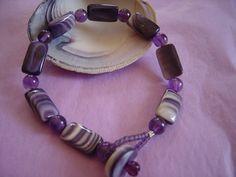 Wampum bracelet with wampum clasp.