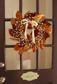 magnolia leaf wreath - would like nice on dinning rm windows.