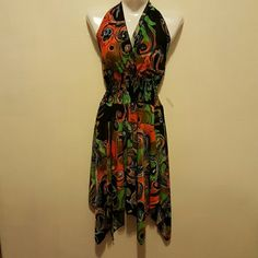 Beautiful tropical dress Preloved in excellent condition ,halter top with spandex material all over its a medium but can also be  worn as a large size because of all the spandex it has. Dresses Asymmetrical
