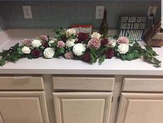 Sola wood flowers, burgandy and dusty rose...used green garland from store