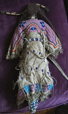 Lakota Beaded and Quilled Doll 1880-1890.  Doll body is of muslin and all beadwork is done with sinew on Native tanned hides. Magnificent doll. Asking over $8,000.00