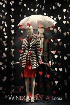Raining heart garlands, mannequins with umbrellas, as a Valentine's shop window display Window Display Retail, Window Display Design, Retail Windows, Shop Windows, Boutique Window Displays, Spring Window Display, Fashion Window Display, Display Windows, Fashion Displays