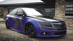 Modified Chevrolet Cruze (Holden Cruze) with Klearz Corner Lenses, black out headlights, Grafxwerks black color Chevrolet bowtie overlay, KMC 20 inch KM775 Rockstar wheels