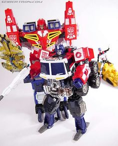 Optimus with gun,wing saber with the star saber and kicker riding op 3