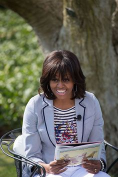 First Lady Michelle Obama reads to children during the 2013 White House Easter Egg Roll on the South Lawn, April 1, 2013.