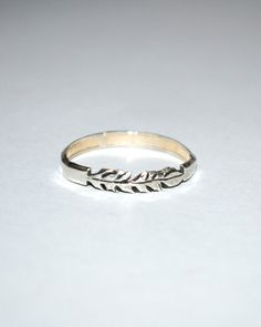 Silver feather ring // layer it.
