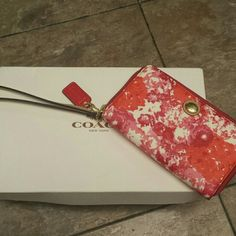 Coach zippy wristlet. Red and pink. New New never used. Measures 4x6. Coach Bags Clutches & Wristlets