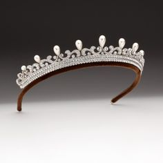 A two row graduated nine plume pearl tiara set with brilliant cut Swarovski crystals mounted on a palladium plated bronze frame. For further details visit www.andrewprince.co.uk Ref H2L1011