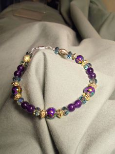 Purple Green and Gold Bracelet by Suestreasures2012 on Etsy, $8.00
