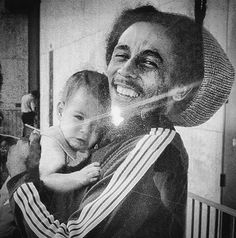 Rare picture of Bob Marley holding baby Damian.