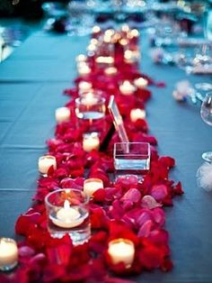 Valentine's Wedding Theme - Candle and Petals Wedding Centerpieces. http://memorablewedding.blogspot.com/2014/02/valentines-wedding-theme.html