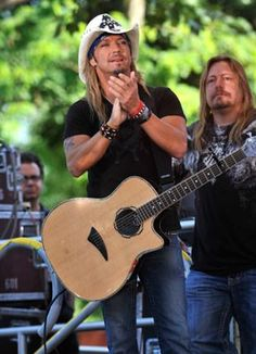 Bret Michaels has that Cody Tuggle look here -- singing to his fans in just a low-key style.  (Pete Evick - guitarist in the background)
