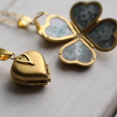 An exquisite heart shaped locket, with multiple spaces for your friends and family inside!When clasped together, the pendant is a great, versatile size, which would look equally good worn short or long. The shorter option, at 46cm, is designed to sit an inch or two below the collar bone, on the chest plate. The longer length is 61cm and is designed to sit at chest level.This beautifully designed locket features a rounded heart shape, with an ornate clasp that opens out to reveal space for…